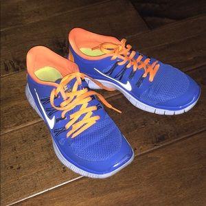 Nike Shoes - Nike Purple and Orange Free Run 5.0 Size 7